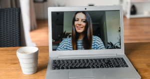A woman on zoom meeting from home