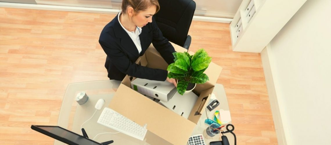 Women packing her stuff in office to finally leave